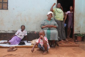 Laura Mokhutle-Flepu seated in chair with her family at Lonmin mine. Picture by Yazeed Kamaldien