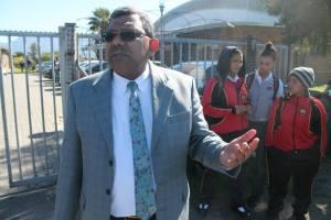 Phoenix High School principal Shafiek Abrahams has a headache on his hands.