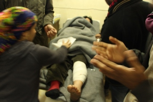 A Kurdish female fighter treated for injuries at a makeshift hospital in Kobane, Syria. Kurdish fighters are still battling IS on Kobane's outskirts. Picture by Yazeed Kamaldien
